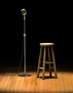 image of microphone and stool on stage